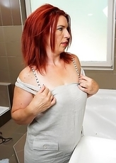 Horny housewife masturbating in her bathroom