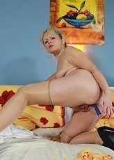 This mature slut loves to fill her pussy with candles