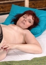 Masturbating housewife getting wet and wild