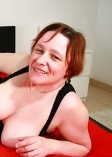 Big breasted mama playing with herself