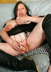 Big breasted mature nympho playing with her wet pussy