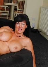 Naughty mature slut playing with her juicy pussy
