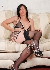 Naughty housewife playing on her couch